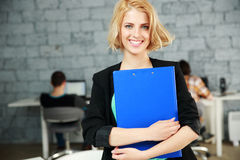 Young happy woman standing with folded Royalty Free Stock Image