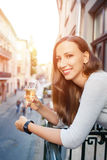 Young happy woman standing with glass of champagne Royalty Free Stock Image