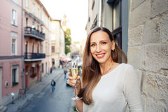 Young happy woman standing with glass of champagne Royalty Free Stock Photography