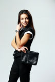 Young happy woman standing and looking away Royalty Free Stock Photos