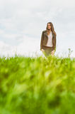 Young happy woman standing outside in green field Stock Photos