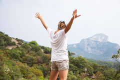 Young happy woman  standing on a rock Stock Image