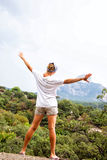 Young happy woman  standing on a rock Stock Photography