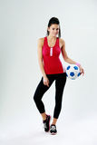 Young happy woman standing with soccer ball Stock Photos
