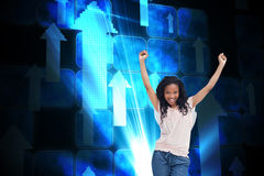 A young happy woman stands with her hands in the air Royalty Free Stock Photo