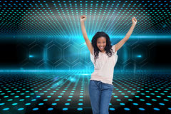 A young happy woman stands with her hands in the air Stock Images