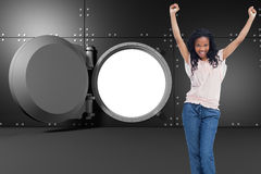 A young happy woman stands with her hands in the air Stock Photography