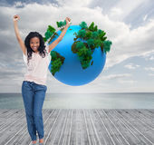 A young happy woman stands with her hands in the air Stock Photo
