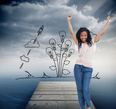 A young happy woman stands with her hands in the air Royalty Free Stock Photography