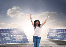 A young happy woman stands with her hands in the air Royalty Free Stock Photos