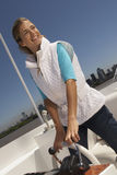Young happy woman steering boat Royalty Free Stock Photos