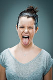Young Happy Woman Sticking Out Her Tongue Royalty Free Stock Photo
