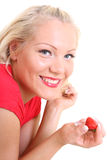 Young happy woman with strawberry Royalty Free Stock Image