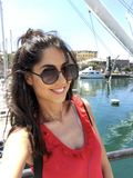 Young Happy Woman with Sunglasses Enjoying her Summer Vacation in Italy royalty free stock photography