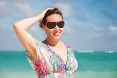 Young happy woman in sunglasses on a sea coast Royalty Free Stock Photos