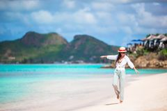 Young beautiful woman on tropical seashore. Happy girl relaxing at white sand tropical beach Stock Images