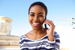 Young happy woman talking on cell phone outside Royalty Free Stock Image