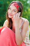 Young happy woman talking on mobile phone Royalty Free Stock Photos