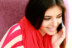Young happy woman talking on the phone Royalty Free Stock Image