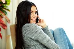 Young happy woman talking on the phone Stock Images
