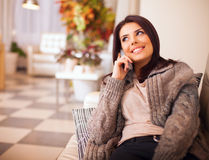 Young happy woman talking on phone Royalty Free Stock Photography