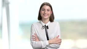 Young happy woman talking to camera. stock footage