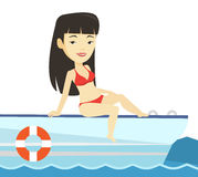 Young happy woman tanning on sailboat. Stock Photos