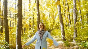Young happy Woman Throwing Autumn Leaves stock video