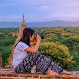 Young happy woman traveling, Asian traveler take a photo on Pagoda and looking Beautiful ancient temples, landmark and popular for. Tourist attractions in Bagan stock images