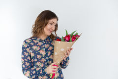 Young happy woman with tulip bunch Royalty Free Stock Photography
