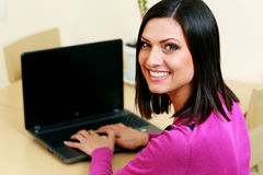 Young happy woman typing on the laptop Royalty Free Stock Photo