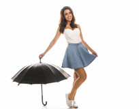 Young happy woman with umbrella. Young happy woman with umbrella over white background Stock Image