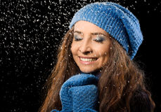 Young happy woman under snowfall Royalty Free Stock Photography