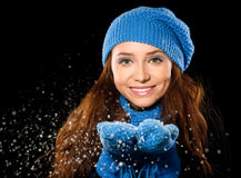 Young happy woman under snowfall Stock Photography