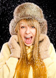 Young happy woman under snowfall Royalty Free Stock Photo
