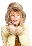 Young happy woman under snowfall Stock Photo