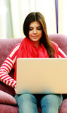 Young happy woman using laptop Royalty Free Stock Images