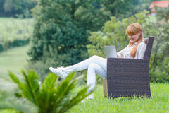 Young happy woman using laptop Stock Photo