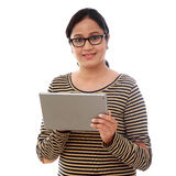 Young happy Woman using a tablet computer against white Stock Images