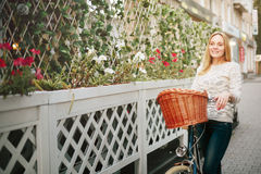 Young Happy Woman on a Vintage Bicycle Stock Photography