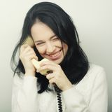Young happy woman with vintage phone Stock Photos