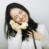 Young happy woman with vintage phone Royalty Free Stock Image