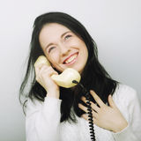 Young happy woman with vintage phone Royalty Free Stock Photography