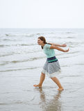 Young happy woman walking on the beach of St.Peter Ording, North Royalty Free Stock Image