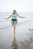 Young happy woman walking on the beach of St.Peter Ording, North Stock Photos