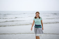 Young happy woman walking on the beach of St.Peter Ording, North Stock Image