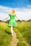Young happy woman walking in a field Royalty Free Stock Photos