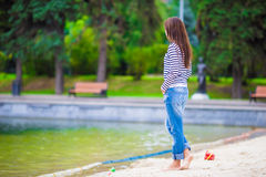 Young happy woman walking near the lake at warm Stock Photo