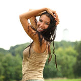 Young happy woman walking in the rain Royalty Free Stock Images
