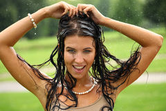 Young happy woman walking in the rain Stock Images